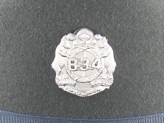 Missouri Highway Patrol silver numbered hat badge