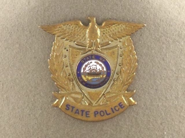 New Hampshire State Police hat badge